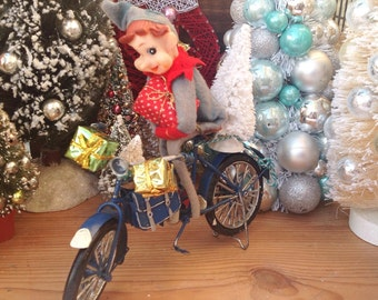 Christmas blue bicycle kneehugger elf, Christmas presents, tree. Mantle decor. Holiday decoration. Christmas decor. Holiday decor. Kitschy.