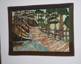 Fiber art quilted wall hanging of bicycling on the bike trail, wall decor, landscape quilt, country scene
