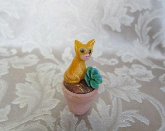 Sitting Kitty, orange cat in a terra cotta pot miniature figurine, dollhouse or fairy garden accessory