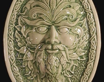 Relief carved Celtic green man ceramic tile/plaque