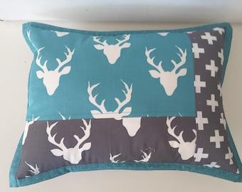 Woodland nursery cushion, turquoise and grey