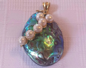 A beautiful Abalone shell pendant with natural pearls