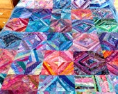 Art Quilt, Machine Pieced and Machine Quilted in Shades of Blue,Purple, Orange and Red with Hand Painted Fabric