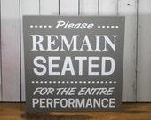 Please Remain Seated/Bathroom Sign/Bathroom Humor/Bathroom Decor/Restroom/Wood Sign/Bathroom/Home decor/Funny/Wood Sign/Black/Ivory