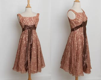 1950s lace party dress with bow
