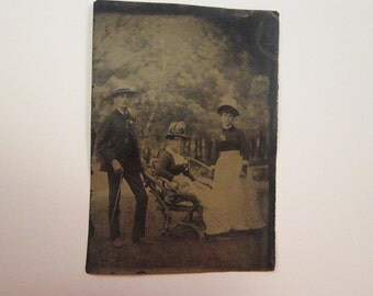 antique tintype photo - man and 2 women holding switches - TT590