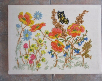 Vintage finished stitchery, field of flowers,  12 by 16 inches, stretched on bars