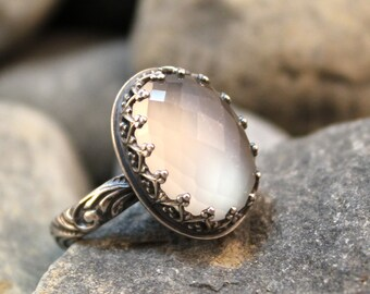 Moon Goddess - 10 x 15mm Checkerboard Faceted Oval Silky White Moonstone in Heart Crown Bezel Sterling Silver Ring