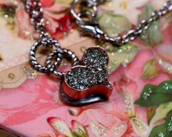 Beautiful tiny hand forged heart, resin and glass glitter filled