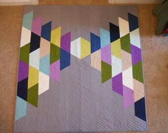 Modern baby quilt in muted colors and gray