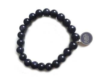 Blue goldstone bead Daruma bracelet