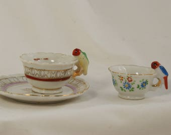 Lot Miniature tea cup and saucer with bird for handle and a miniature tea cup bird handle made in Japan.