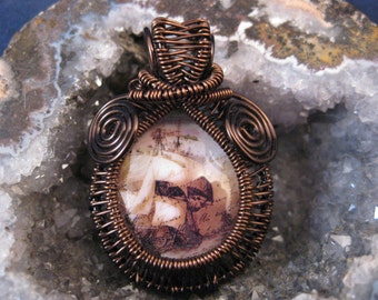 Wire wrapped pendant with nautical glass cabachon