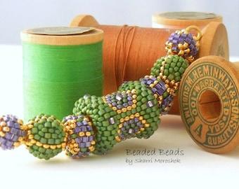 Sale - reduced 25% - Beaded Beads set of 7 - by Sharri Moroshok