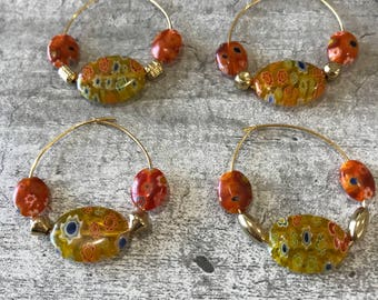 Set of 4 Bright Yellow and Orange Wine Charms.