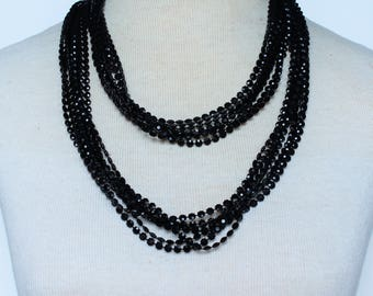 Vintage 70s Multi Seven Strand Opaque Black Long Flapper Rope Length Multistrand Faceted Plastic Beaded Necklace