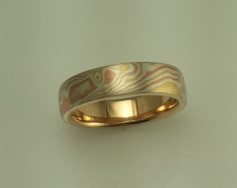handmade wood grain wedding band mokume gane 14k red gold 18k yellow gold and sterling