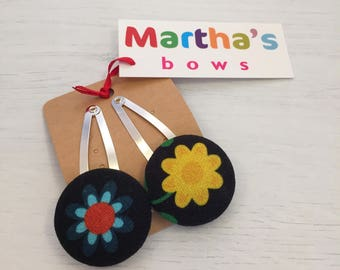 Sixties flower power, black and bright, pair of button snap clips