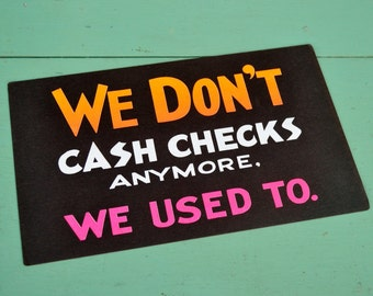 """Vintage Black Neon Sign """"We Don't Cash Checks Anymore"""" Business Store Poster White Pink Orange Cardstock Paper No Checks Cashed"""