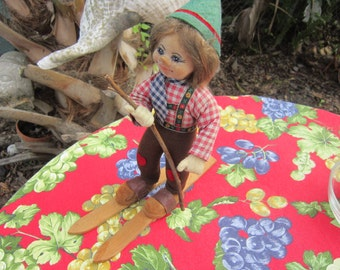 1980's austrian skiing doll,,wood skis, painted face,,very unusual
