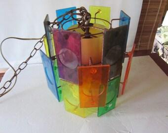HUGE  SALE...mid century hanging light fixture. sonic. plastic multi colored.most unusual