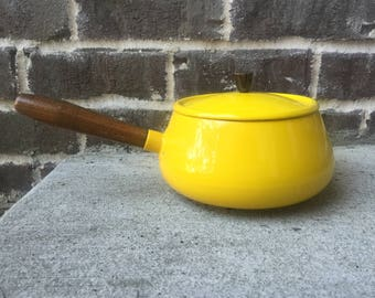 Yellow ceramic coated cooking pot