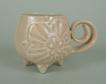 Round shaped Pink Mug - Curly Handle and Feet