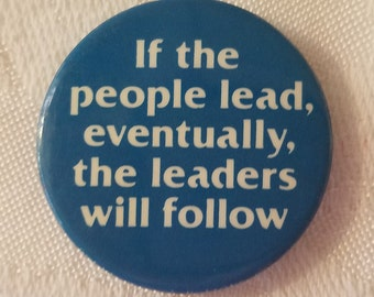 """Vintage button that reads """"If the people lead, eventually the leaders will follow"""""""