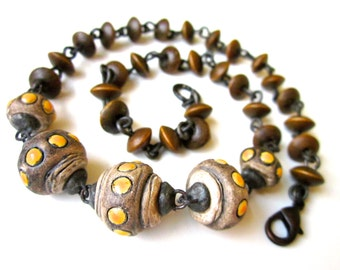 The Time Inbetween the Seconds - primitive tribal dark industrial yellow brown weathered ceramic art beads, solder, wood beads necklace