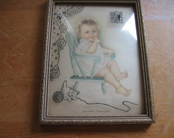 Framed Lithograph of Baby in a Chair