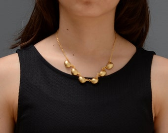 short gold necklace, gold bib necklace, gold shell necklace, gold necklace, modern necklace, abstract gold necklace, minimal gold necklace