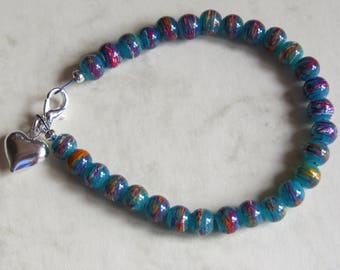green purple and orange draw bench glass bead bracelet