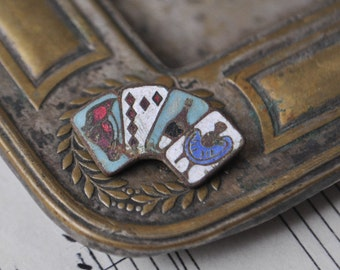 "Antique copper enamel button ""Playing cards""."