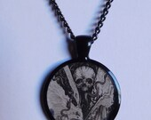 SALE Skull and snakes 1 inch resin Pendant Necklace