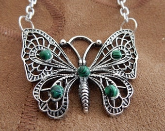 Butterfly pendant with green malachite beads.