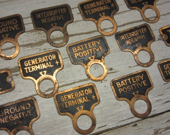 Collection of 13 Vintage Brass Metal Tags Battery Label Industrial Steampunk Label Tags Brass and Black Jewelry Artwork Art Craft Supply Old