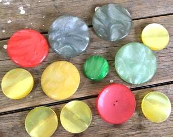 12 Large Buttons in green , yellow and red, biggest are 2.25 inch diameter