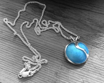 Sterling silver pendant locket with stunning light blue enamel. Hallmarked at the London Assay Office.
