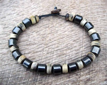 Mens surfer bracelet, hematite and horn beads, magnetic hematite, handmade from earthy natural materials, strong cord, toggle and loop clasp