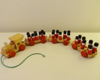 WOODEN TOY TRAIN - Vintage Troop Train Pull Toy - Engine, 3 Detachable Cars & 22 Grenadier Guards Soldiers - British Made