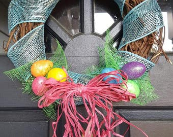 "11"" Easter Egg Grapevine Wreath! Welcome Spring with these cute eggs nestled in the grass!"