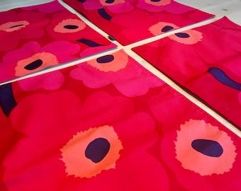 Four Marimekko Placemats in Unikko Pattern