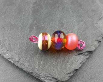 Cerise pink and ivory mini lampwork bead set