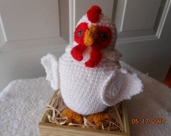 crochet chicken sitting on eggs