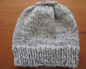 Hand knit woman's light grey tweed 100% thick acrylic pony tail or messy bun hat