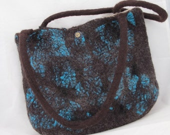Felted bag with bead embroider bullet casing magnetic closure,  one pocket and felted handles.  Wet felted with brown merino wool