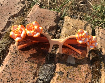 Peach and orange retro flower sunglasses