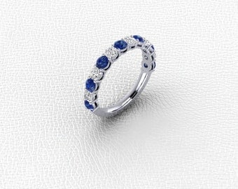 14K white gold shared prong Sapphire and diamond band.
