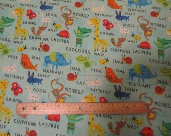 Blue with Multicolor Animals and Words Flannel Fabric  by the Yard