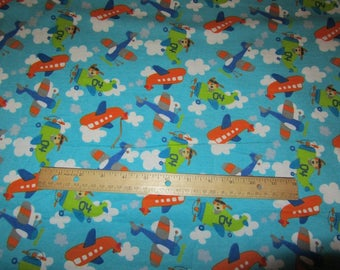 Blue Dogs in Airplane Flying in Clouds  Flannel Fabric  by the Yard